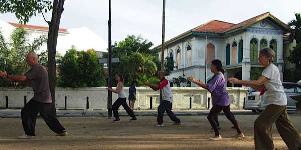 Group of TaiChi learners practicing outdoors